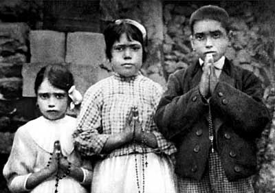 Children (Seers) of Fatima Lucia Santos, Jacinta Marto, Francisco Marto holding their rosaries. (1917 A.D.)